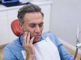 urpi-dental-unhappy-man-having-a-toothache-KHT4GSB